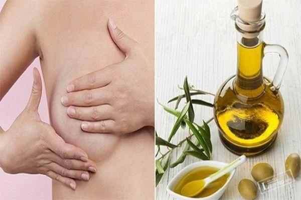 Massage ngực bằng tinh dầu, dầu dừa.